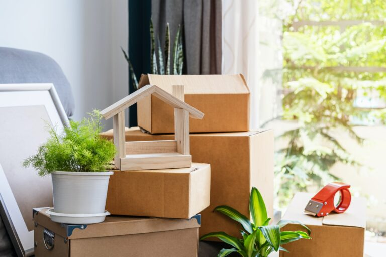 Stack of cardboard boxes in living room at new house on moving day